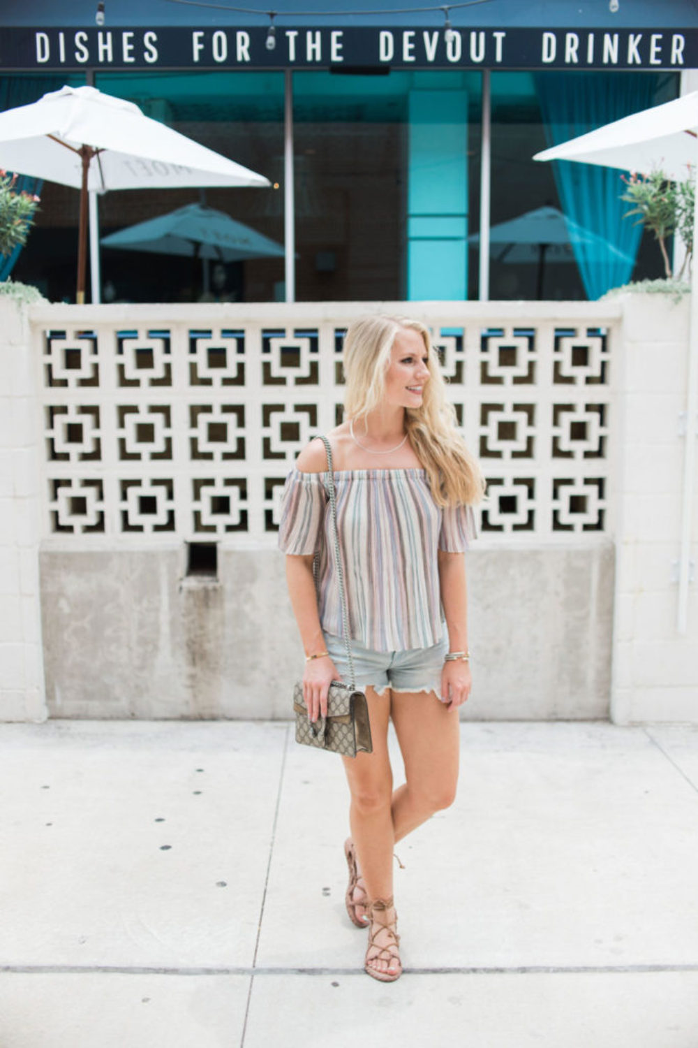 Fashion blogger The Trendy Tomboy wears BP Pleated Off the Shoulder Top and American Eagle Outfitters High Rise Shorties